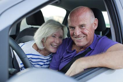 happy elderly driving