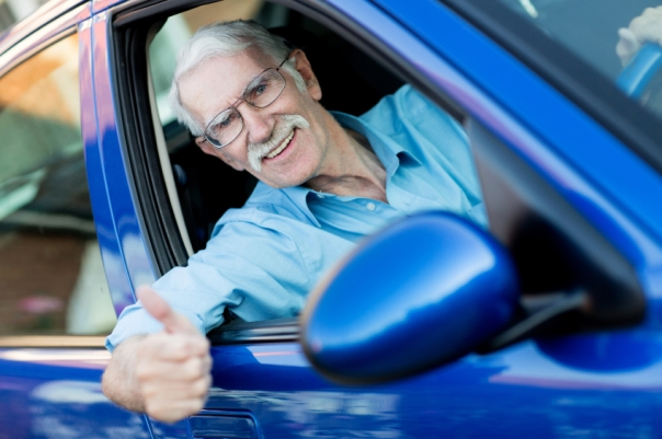 Male driver with thumbs up