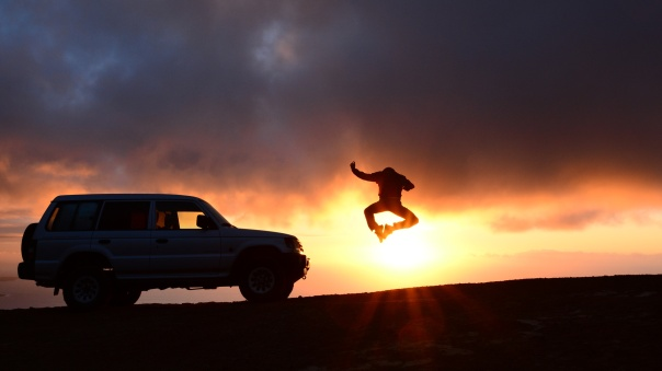 Man Jumping by a Car