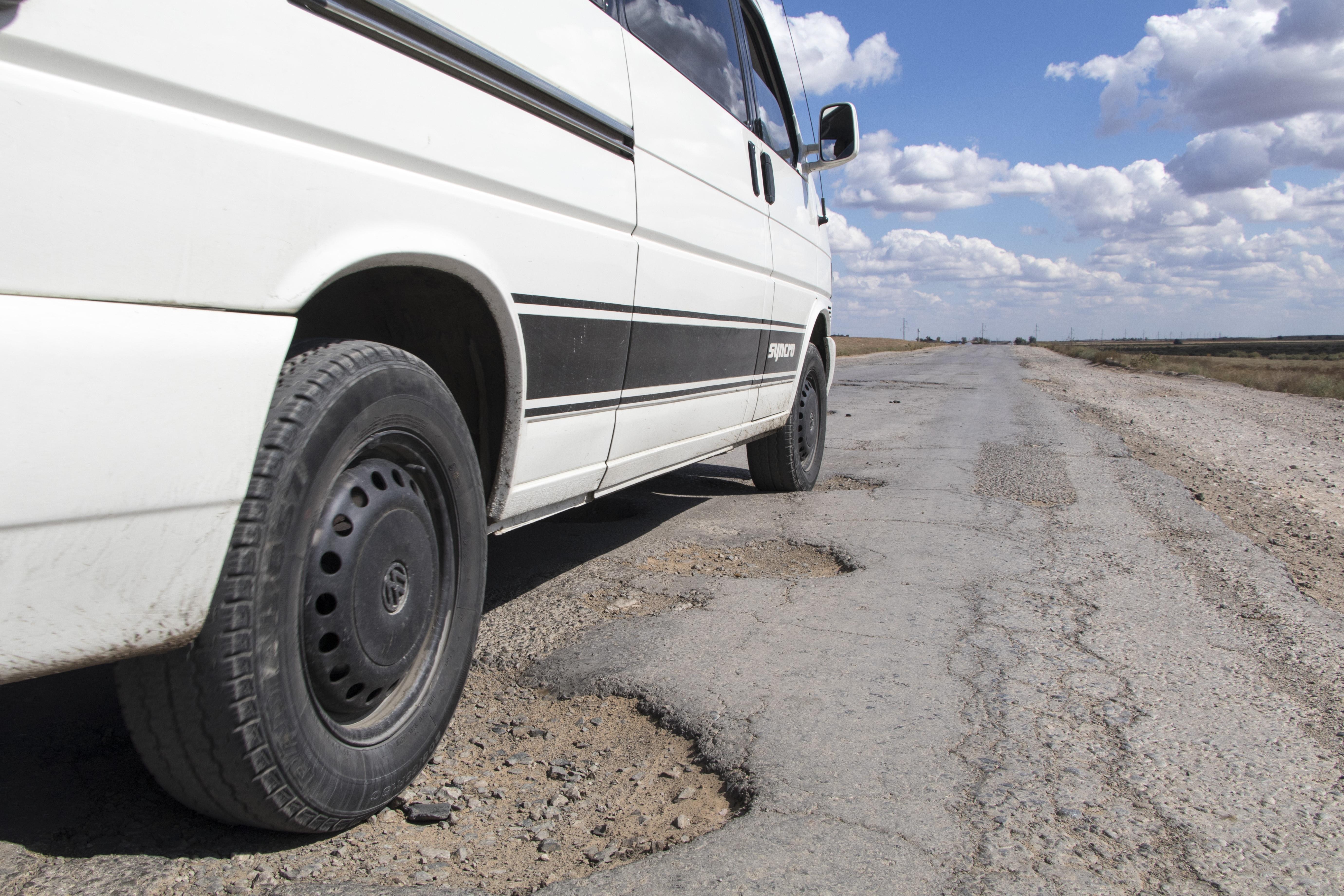 road-car-hole-volkswagen-van-asphalt-481555-pxhere.com.jpg