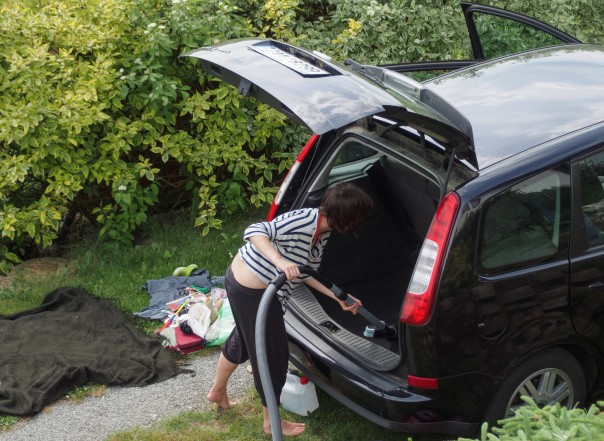 woman cleaning her car